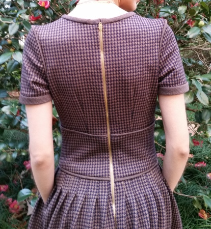 houndstooth winter dress with exposed zipper and pockets