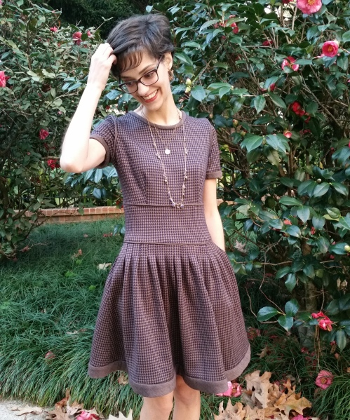 houndstooth knit wool dress with pleated skirt and pockets