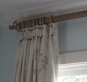 custom drapes with inverted pleats and covered buttons