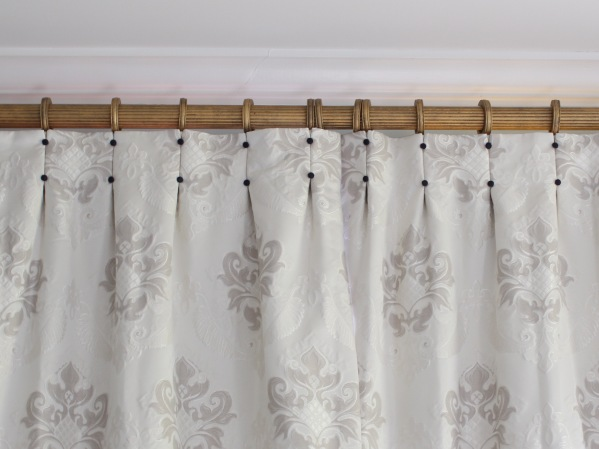 cream drapes with navy covered buttons