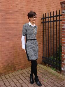 short sleeve sweater dress layered over button up shirt